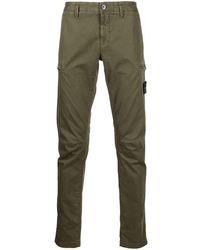 Stone Island - Pantalon slim à poches cargo - Lyst