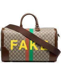 Gucci Sac fourre-tout à imprimé Fake/Not - Marron