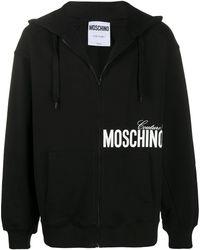 Moschino Sweat à capuche à logo imprimé - Noir