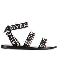 Givenchy Sandalias con tiras cruzadas y logo - Negro