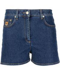 Moschino Pantalones cortos vaqueros con parche del logo - Azul