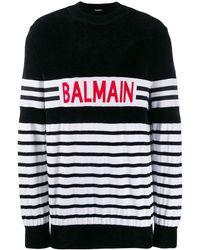 Balmain Gestreifter Pullover mit Logo - Schwarz