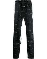 Fear Of God Pantalones de chándal con logo - Negro