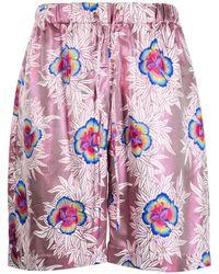 Edward Crutchley Pantalones cortos de satén con estampado floral - Rosa