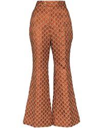Gucci Расклешенные Жаккардовые Брюки С Узором GG Supreme - Оранжевый