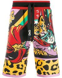 Dolce & Gabbana Pantalones cortos de deporte con estampado de cómic - Negro
