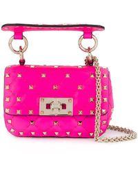 Valentino Garavani Micro Rockstud Spike Crossbody Bag - Розовый