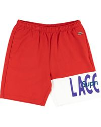 Supreme X Lacoste Joggingshorts mit Logo - Rot
