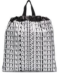 Balmain Sac à dos à logos imprimés all-over - Noir