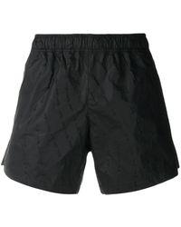 Off-White c/o Virgil Abloh Pantalones cortos de deporte con costura con flechas - Negro
