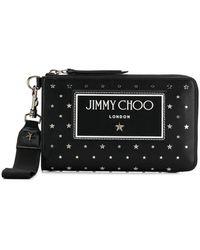 Jimmy Choo Pochette à patch logo et clous - Noir