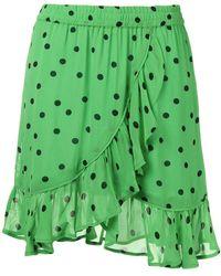 Ganni Dotted ruffle mini skirt - Grün