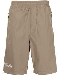 Izzue Logo-print Elasticated-waist Deck Shorts - Brown