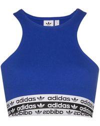 adidas Sujetador deportivo con franja del logo - Azul