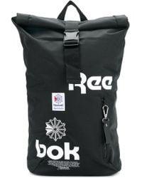 Reebok - Logo Print Buckle Strap Backpack - Lyst