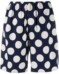 AMI Pantalones cortos con motivo de lunares - Azul