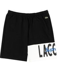 Supreme X Lacoste short à logo - Noir