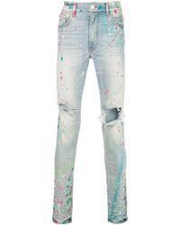 Amiri Faded Distressed Jeans - Blue