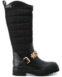 2c4f74d1c14 Lyst - Moschino Buckled Leather Thigh Boots in Black