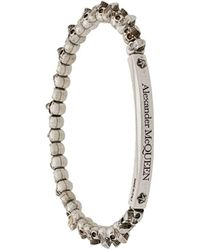 Alexander McQueen Bracelet à breloques têtes de mort - Multicolore