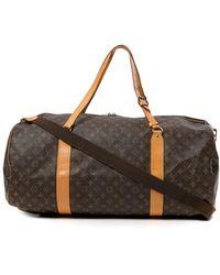 Louis Vuitton - サックポロション 2way トラベルバッグ - Lyst