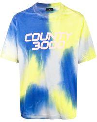 Marcelo Burlon T-shirt imprimé tie-dye à logo - Bleu