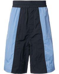 AMI Shorts sportivi oversize
