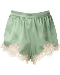 Dolce & Gabbana Short à empiècements en dentelle - Vert