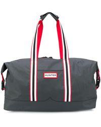 HUNTER Logo Patch luggage Bag - Black
