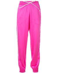 Amiri Pantalones de chándal con raya lateral - Rosa