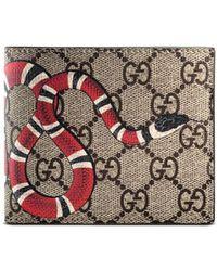 Gucci - Cartera GG Supreme con serpiente - Lyst