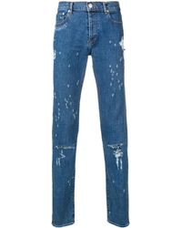 Givenchy Jean slim à effet usé - Bleu