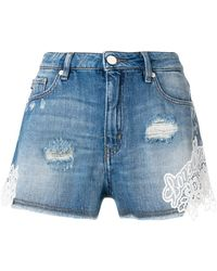 Love Moschino | Lace Trim Distressed Shorts | Lyst