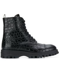 Prada Circle Embossed Ankle Boots - Black