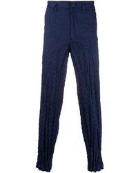 Issey Miyake Pantalon droit à effet froissé - Bleu