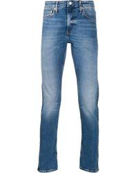 Calvin Klein Jean droit à effet délavé - Bleu