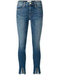 FRAME Jean skinny crop à fentes - Bleu