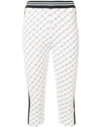 Stella McCartney - Branded Cropped leggings - Lyst