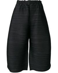 Pleats Please Issey Miyake Culottes anchos con pliegues - Negro