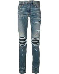 Amiri Gescheurde Skinny Jeans - Blauw