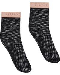 Gucci Chaussettes en résille à logo - Noir
