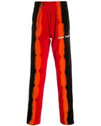 Palm Angels Pantalon de jogging à imprimé tie dye - Rouge