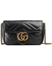 Gucci Стеганая Мини-сумка GG Marmont - Черный