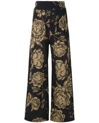 Osklen Pantalones anchos con motivo floral - Negro