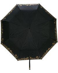 Alexander McQueen Parapluie à tête de mort - Noir