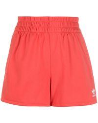 adidas Pantalones cortos de jersey con ribete de rayas - Rojo