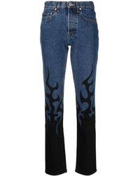 Vetements Flame-print Skinny-cut Jeans - Blue