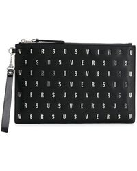 Versus - Logo Studded Pouch Bag - Lyst