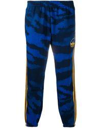 adidas Pantalones de chándal con motivo de tigre - Azul