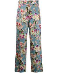 Junya Watanabe Pantalones acampanados con estampado floral - Azul